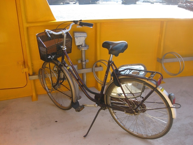 A bicycle stand on a ferry.