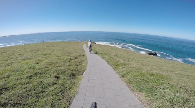 We roll over the headland's crest and around its front. I'm not sure if this is intended as a bike trail but with few people around, we  take the opportunity to enjoy the view!