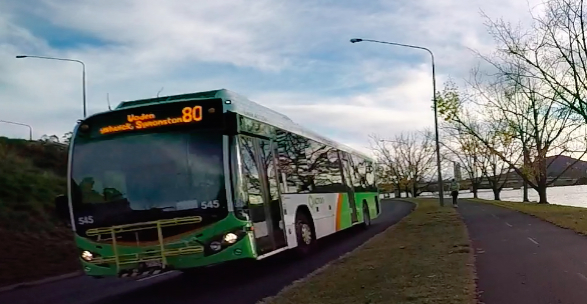 Canberra buses are equipped with yellow bicycle racks so commuters can integrate bike travel with bus travel.