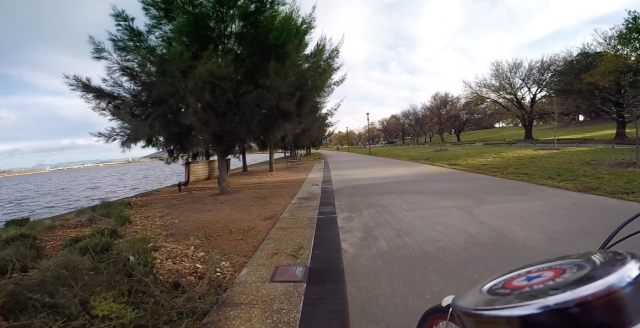 Riding by Lake Burley Griffin.