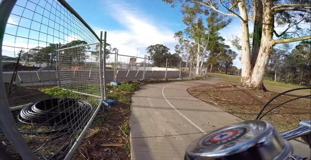 Weaving around the construction of an underpass for safer cycling and pedestrian.