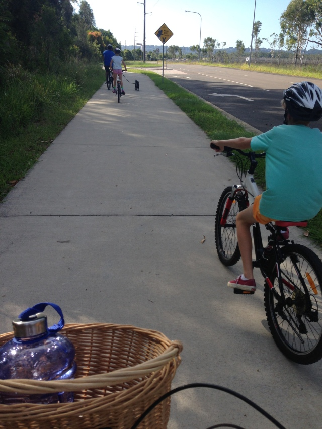 Family bike ride with Fluffy the dog running along too.