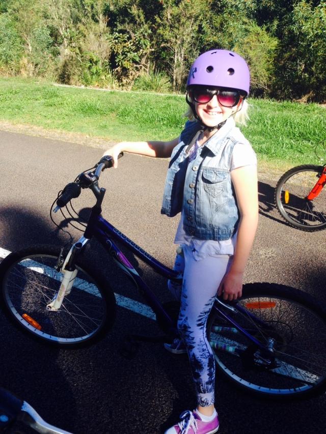 Style rider with cool coordinates - purple bike, purple shoes, purple helmet.